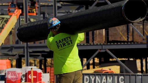 Worker wearing safety first shirt