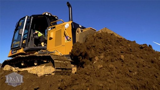 Bulldozer moving dirt on site